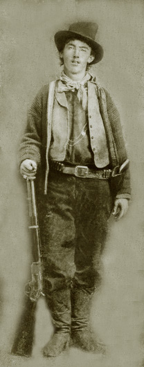 Billy the Kid with his guns